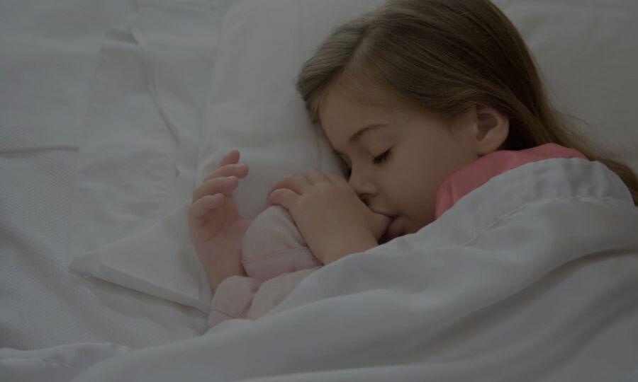 Young girl asleep while thumb sucking