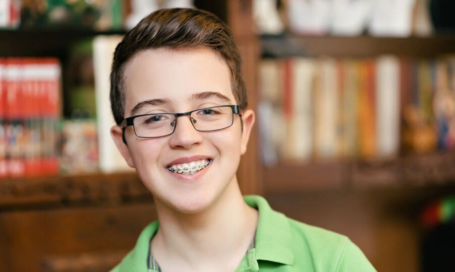 Young teenage boy with braces smiling