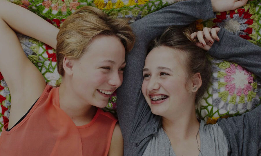 Teens-With-Braces-Laughing-Having-Fun-Smiling