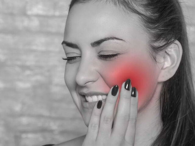 Woman-With-Jaw-Pain-TMD-TMJ