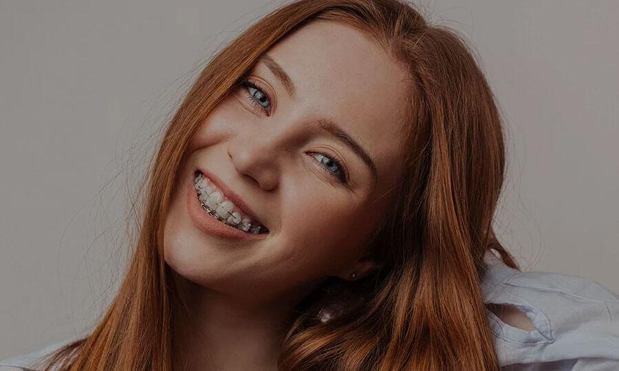 Teen-Straightening-Teeth-With-Braces