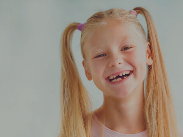 Little-Girl-Loses-Tooth-Smiling